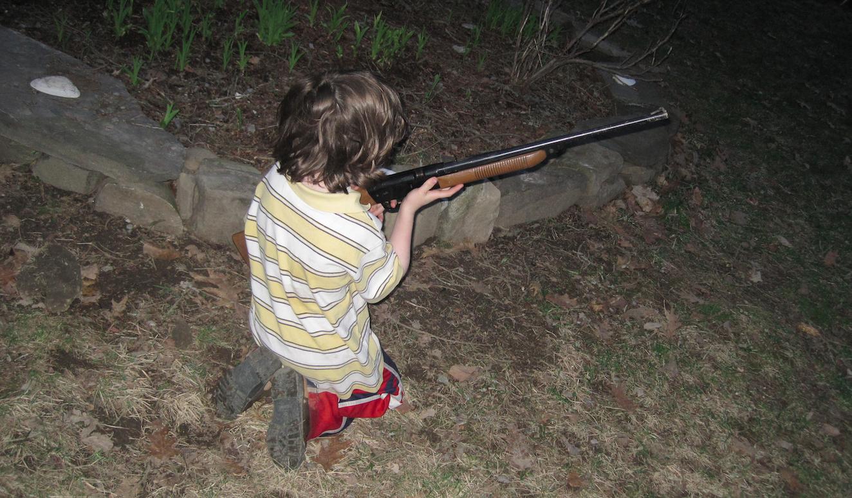 Kid with gun, upstate NY, 2010
